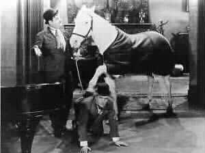 Laurel and Hardy with horse