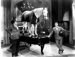 Laurel and Hardy with horse on piano